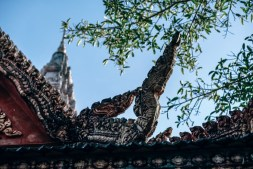 Traditional-Asian-Roof-with-the-Sky-and-Tree-Leaves-in-the-Background