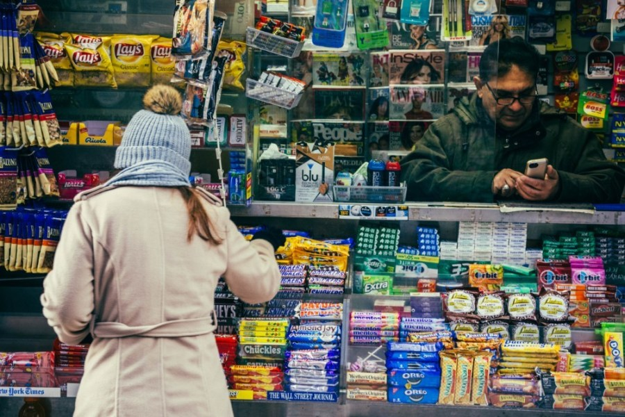 Woman-Shopping-for-Candy-at-a-Convenience-Store
