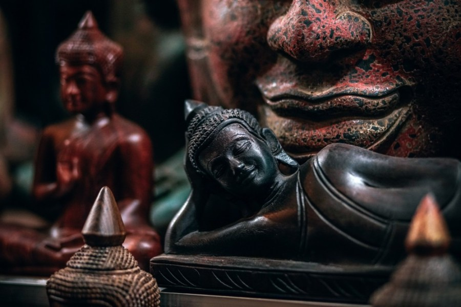 Wooden-Buddha-Statue-in-front-of-Other-Buddhist-Statues-for-sale