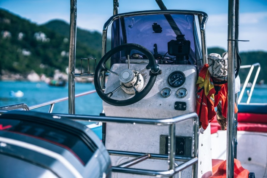 Boat-Helm-with-Tropical-Islands-in-the-Background