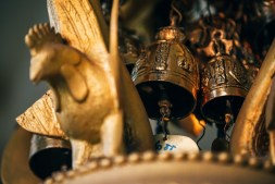 Close-up-Shot-of-Golden-Brass-Bells-at-a-Thai-temple