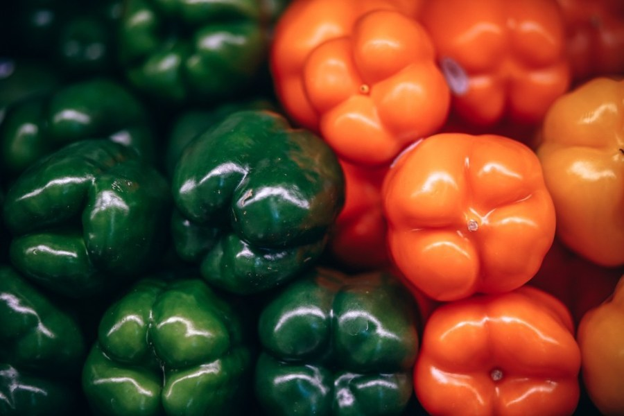 Close-up-Shot-of-Organic-Green-and-Orange-Bell-Peppers