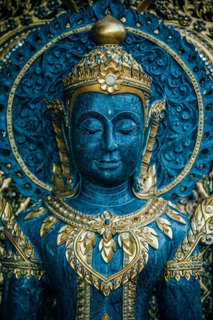 Close-up-Shot-of-a-Blue-and-Golden-Buddhist-Statue-inside-Doi-Suthep-Temple