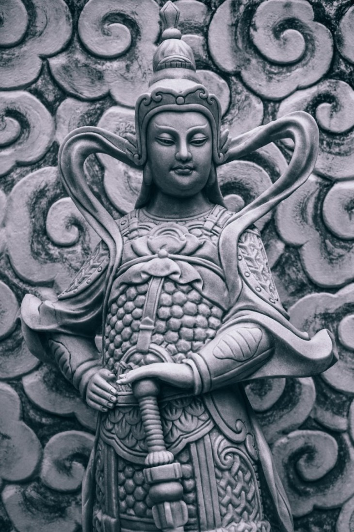 Close-up-Shot-of-a-Buddhist-Warrior-Statue