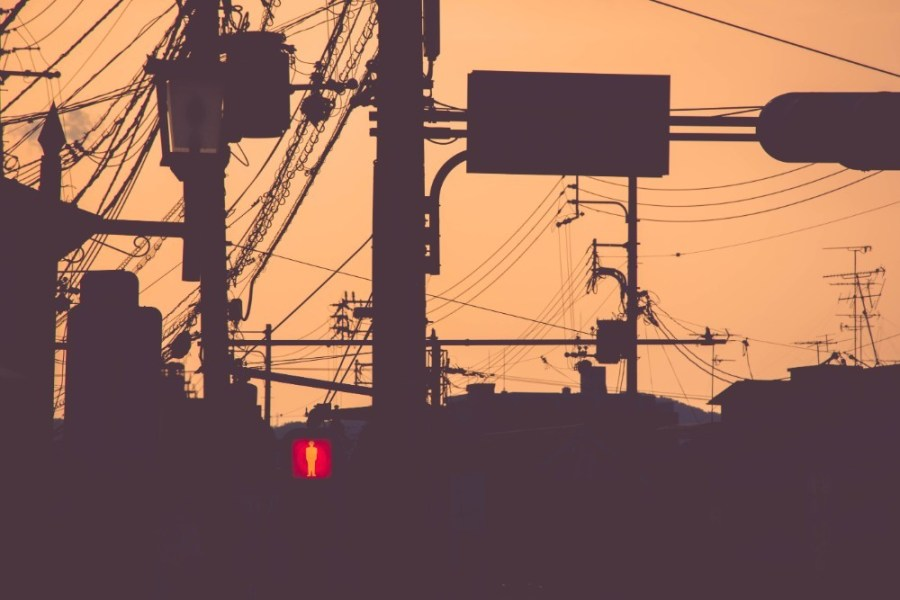 Electricity-Poles-and-Cables-in-Kyoto-with-the-focus-on-a-Red-Pedestrian-Traffic-Light