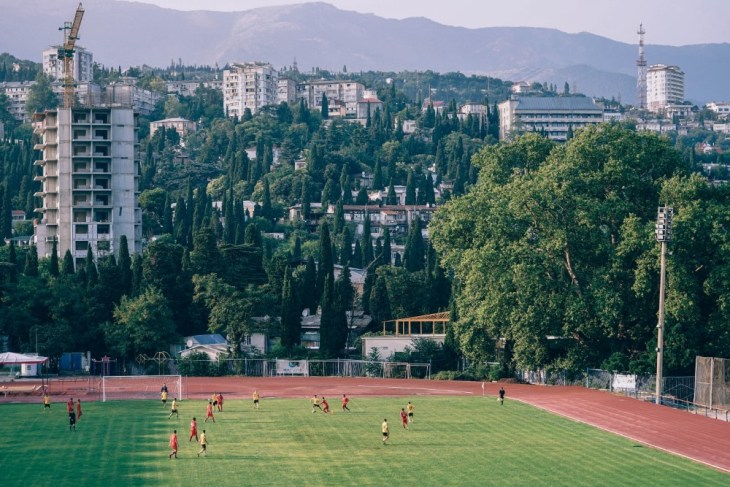 Football-Pitch-in-Yalta-Photographed-with-the-City-and-the-Mountains-in-the-Background