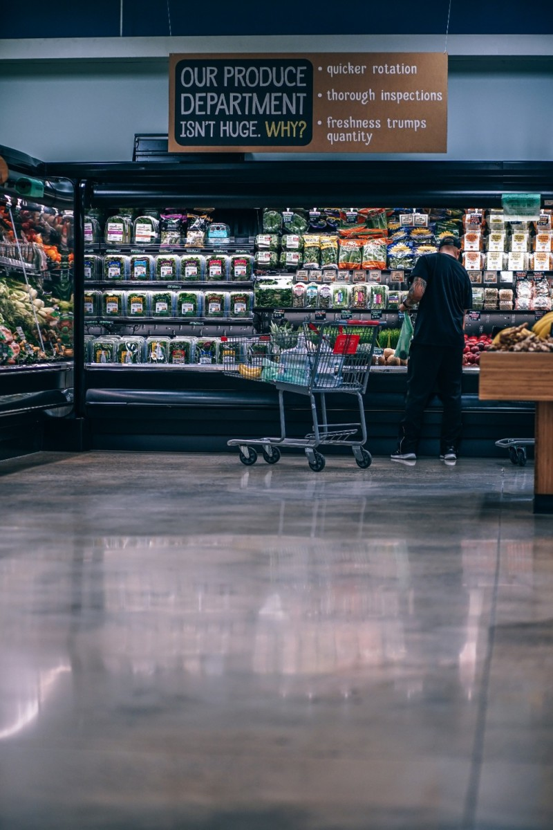 Man-Picking-Out-Fruit-at-an-Organic-Grocery-Store