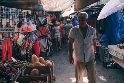 Man-Shopping-at-the-Local-Market-in-Yalta