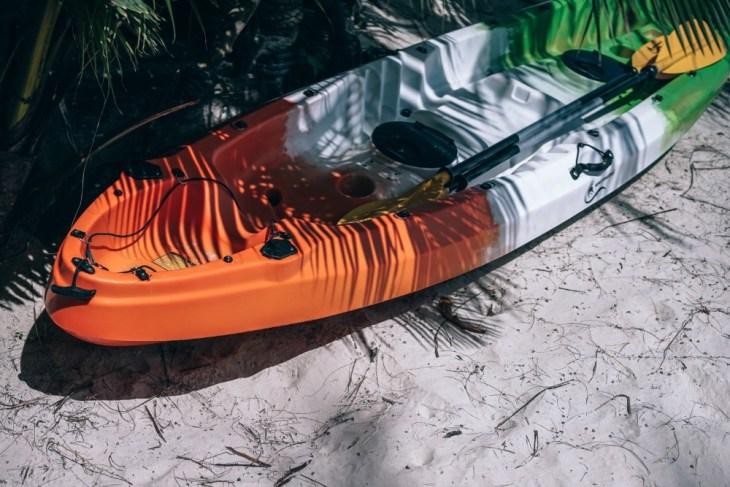 Modern-Kayak-on-the-Beach-under-a-Palm-Tree-Shadow