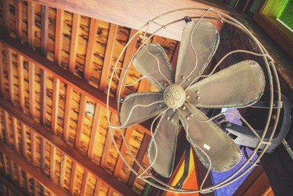 Old-Dusty-Fan-Attached-to-a-Wall