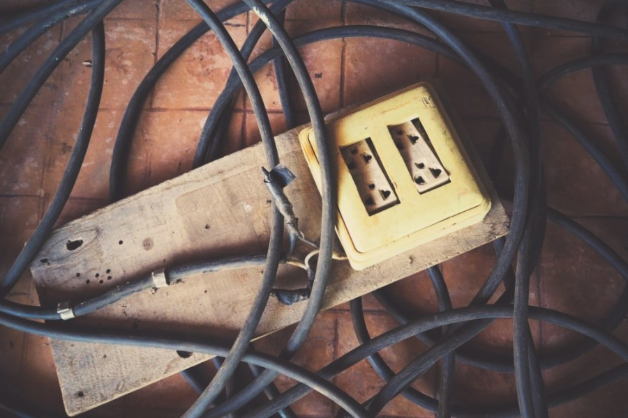 Old-Electric-Socket-Attached-on-a-Wooden-Board