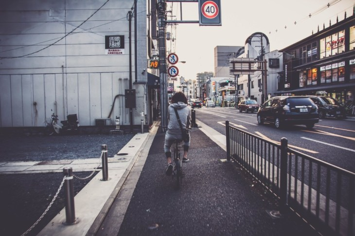 Person-Cycling-through-Kyoto-Japan