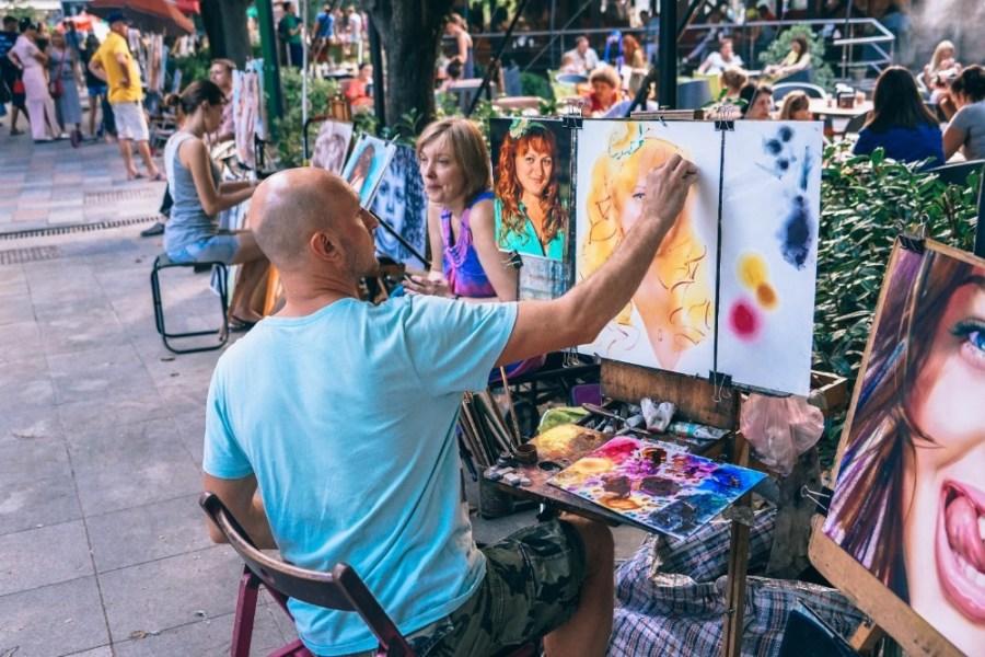Street-Artist-Working-on-a-Woman's-Portrait