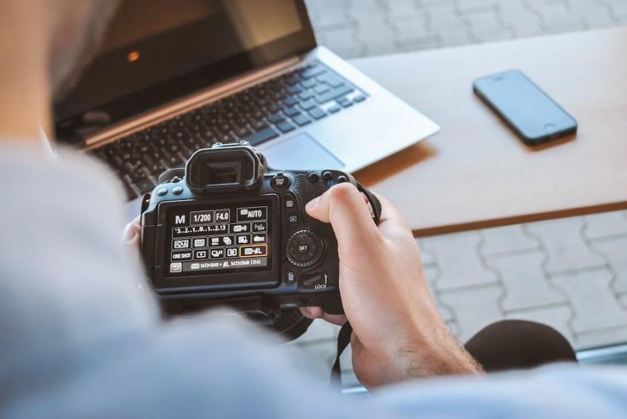 man-setting-camera