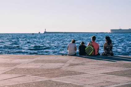 Family-Sitting-by-the-Shore-in-Sevastopol