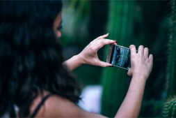 Girl-Taking-a-Photo-of-Cactuses-with-her-Mobile-Phone
