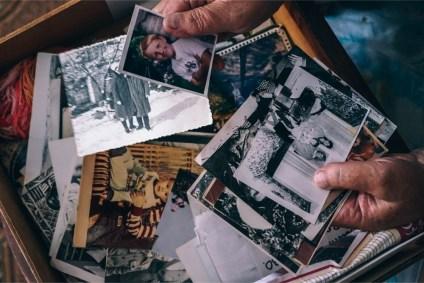 Hands-Going-Through-Old-Family-Photos