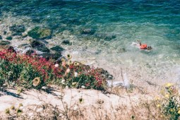 Kid-Swimming-near-the-Shore-in-Sevastopol
