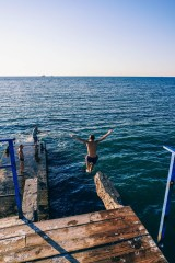 Man-Jumping-from-the-Dock-1