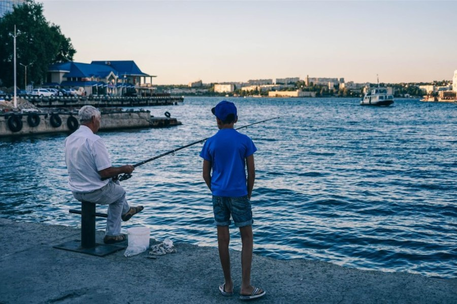 Old-Man-Teaching-his-Grandson-to-Catch-Fish