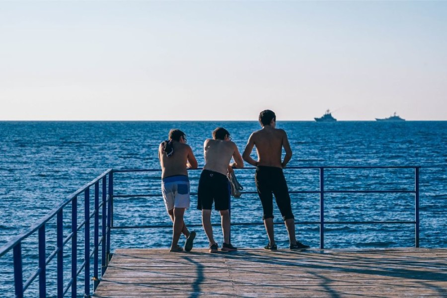 Three-Friends-Chilling-by-the-Shore