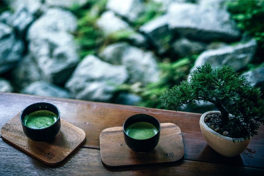 Two-Cups-of-Matcha-Tea-Served-on-Wooden-Boards-at-the-Magokoro-Japanese-teahouse