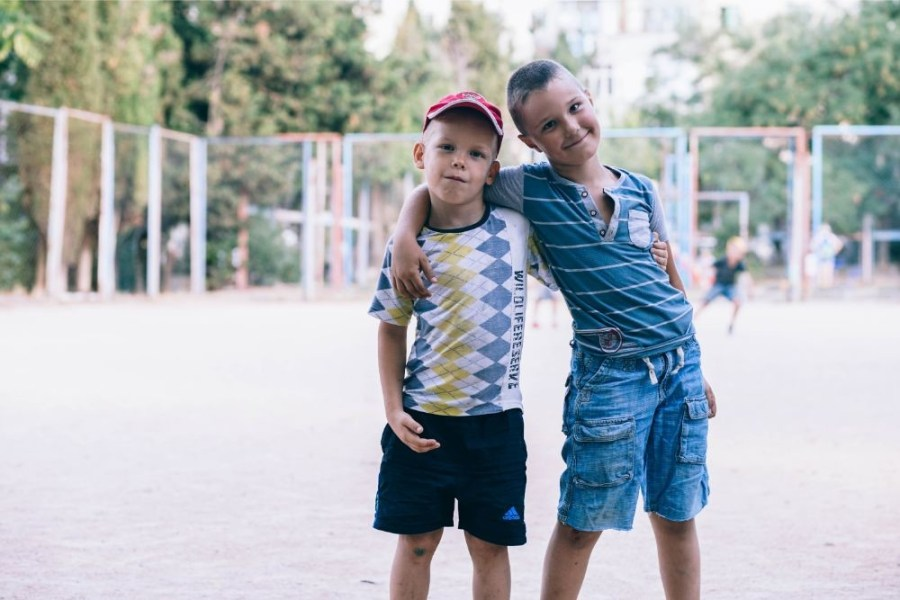 Two-Kids-Hugging-and-Posing-at-a-Soccer-Field-in-Sevastopol
