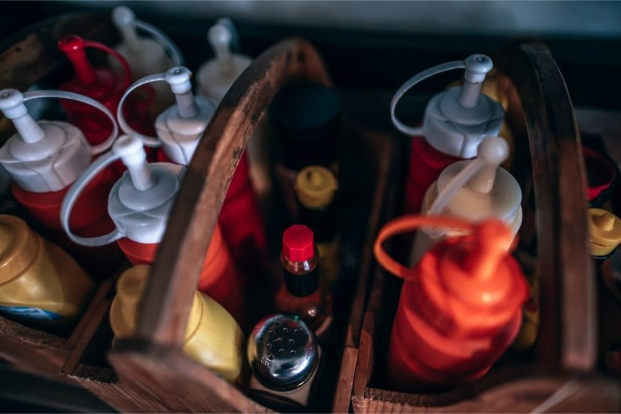 Wooden-Box-Full-With-Condiment-Bottles
