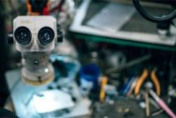 Close-up-Shot-of-Binoculars-in-a-Mobile-Repair-Shop