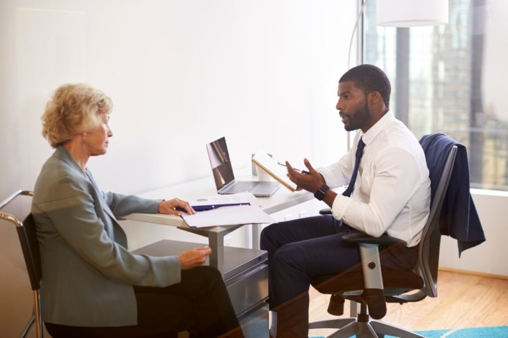senior-woman-meetings-with-male-doctor-financial-6HJRKUS