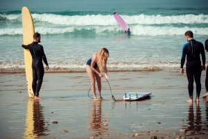 surfer friends on a beach with a surfing boards PBPQRK