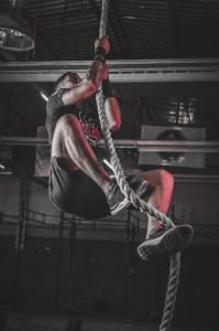 man climbing on rope