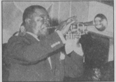 Louis Armstrong performing at Fancy Dress in 1957
