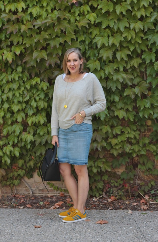 casual fall outfit featuring an off the shoulder sweatshirt and a denim skirt, over 40 style blogger, over 40 fashion blogger, Detroit blogger