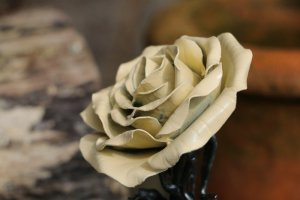 Picture of a handmade yellow satin finished metal steel rose by Bob Iles of Fandangle Crafts