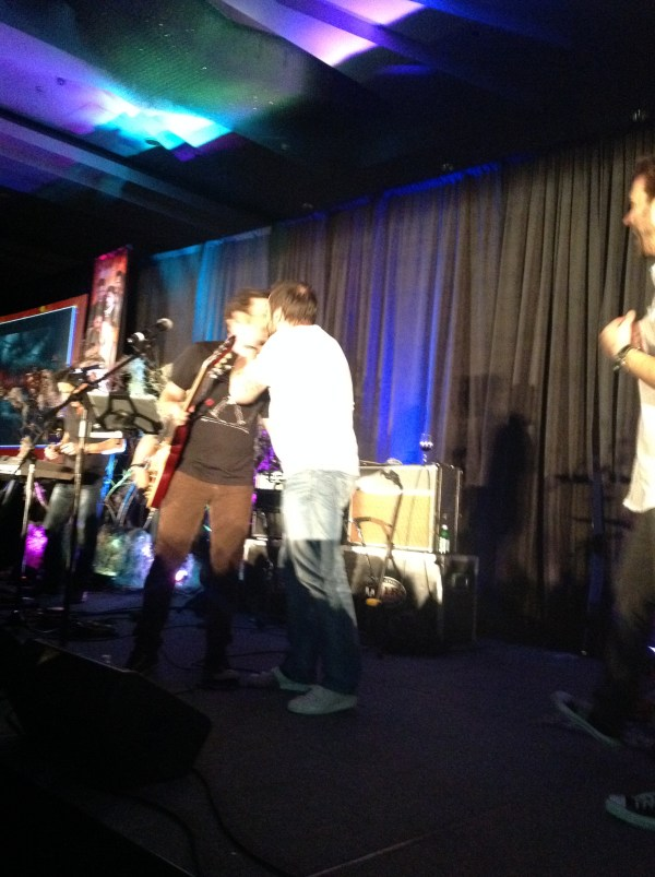 Mark gives Rob a kiss as he leaves the stage