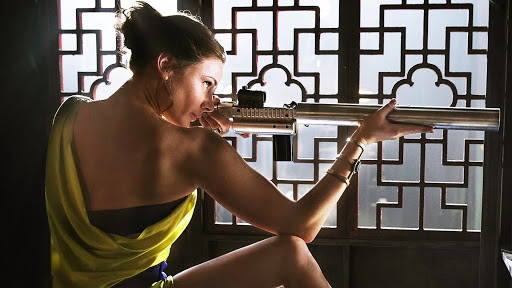 Ilsa Faust (rebecca ferguson) in yellow dress in mission impossible rogue nation
