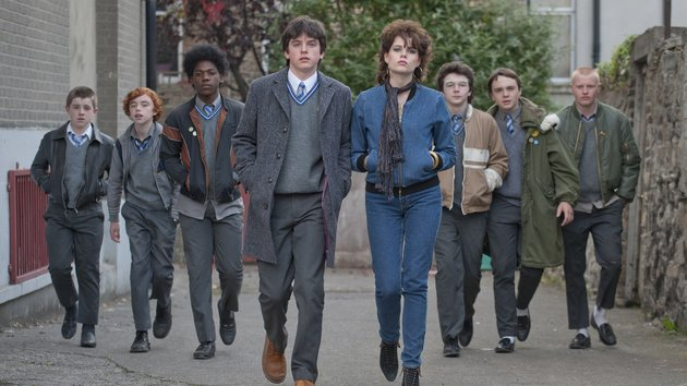 The cast of sing street posing for an album picture and walking down an alley