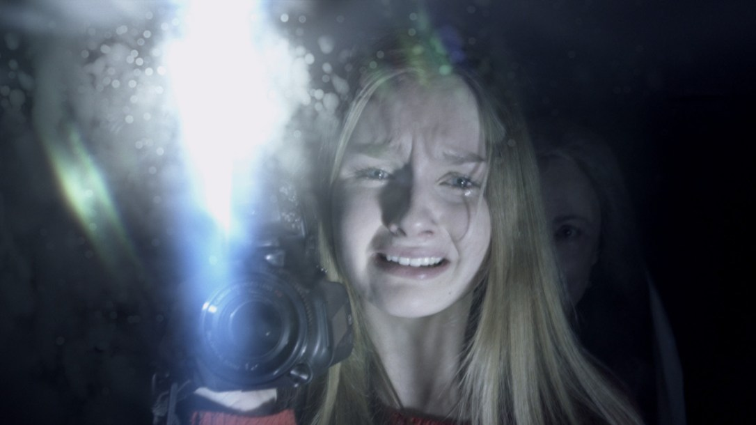 Creepy image of scared young girl with older woman behind her