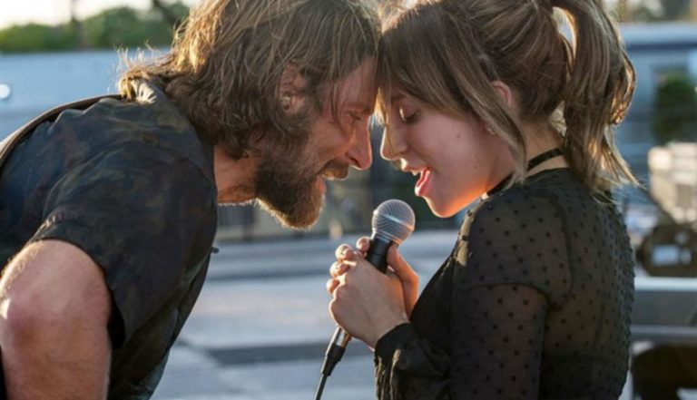 Bradley Cooper and Lady Gaga singing outside in A Star Is Born