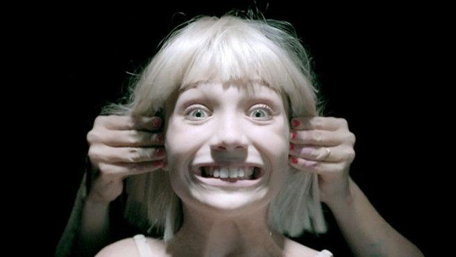 Sia making Maddie Ziegler smile