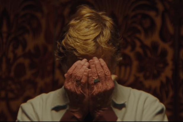 Robert Redford hiding his face in The Discovery movie