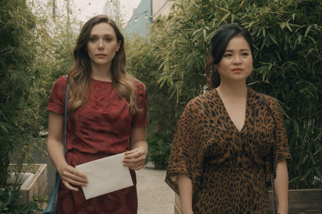 Elizabeth Olsen and Kelly Marie Tran walking in Sorry For Your Loss