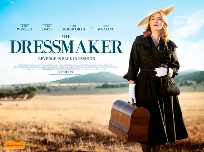 Kate Winslet with a suitcase in The Dressmaker