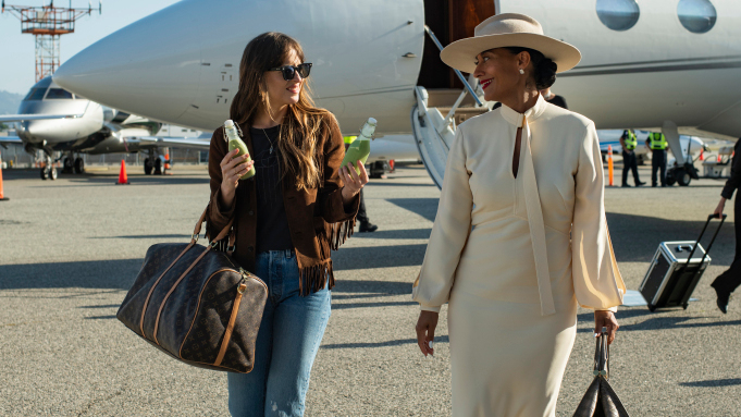 Dakota Johnson and Tracee Ellis Ross  stepping off a plane in The High Note