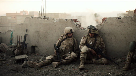 soldiers covering behind a wall in the yellow birds