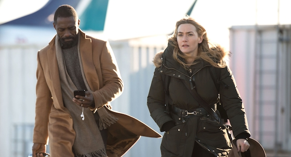 Idris Elba and Kate Winslet going to the airplane in The Mountain Between Us