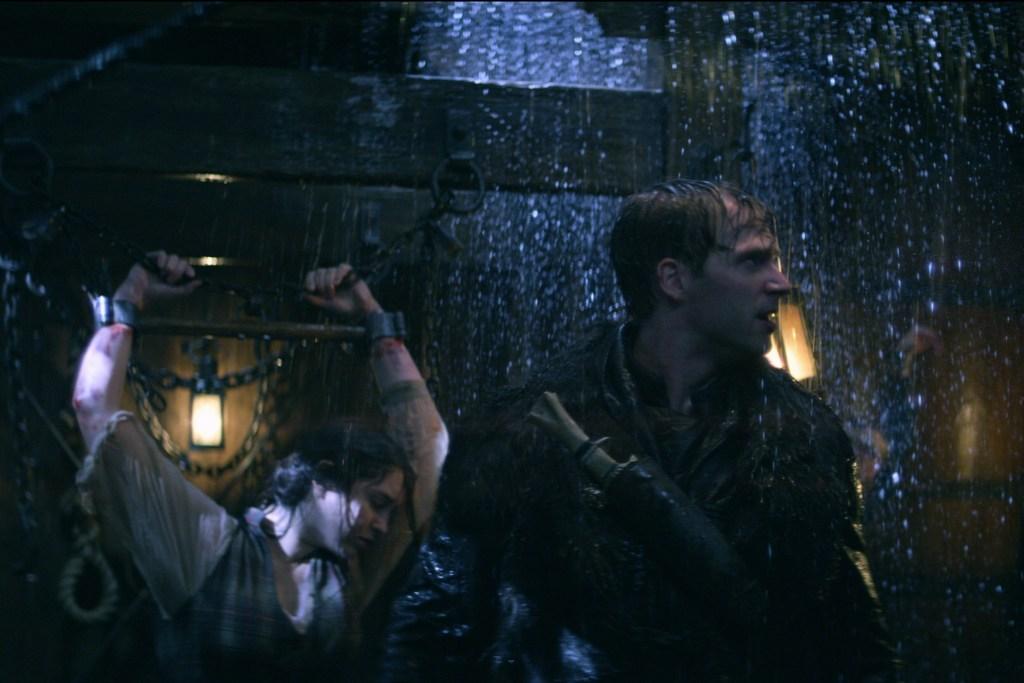 SHADOW AND BONE (L to R) DANIELLE GALLIGAN as NINA ZENIK and CALAHAN SKOGMAN as MATTHIAS HELVAR in SHADOW AND BONE