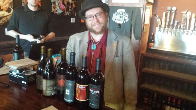 Cody Burkett with wine bottles