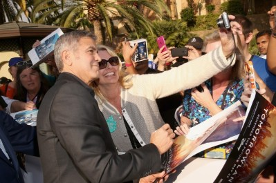 "ANAHEIM, CA - MAY 09: Actor George Clooney takes a selfie with a fan at the world premiere of Disney's ""Tomorrowland"" at Disneyland, Anaheim on May 9, 2015 in Anaheim, California. (Photo by Jesse Grant/Getty Images for Disney) *** Local Caption *** George Clooney"